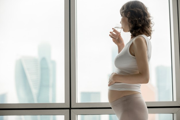 pregnant woman with glass water 1163 1510